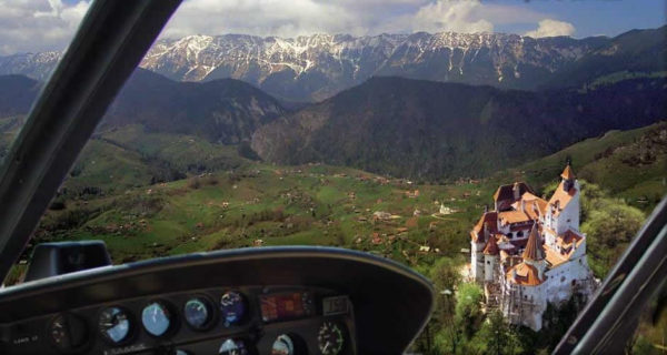 fly over Dracula's Castle in a Dracula tour in Romania-airplane Dracula tours from Brasov over Bran Castle